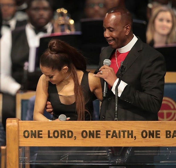Bishop Charles Ellis chats with Ariana Grande after her performance at the funeral for Aretha Franklin at the Greater Grace Temple on August 31, 2018 in Detroit, Michigan. Franklin, 76, died at her home in Detroit on August 16.