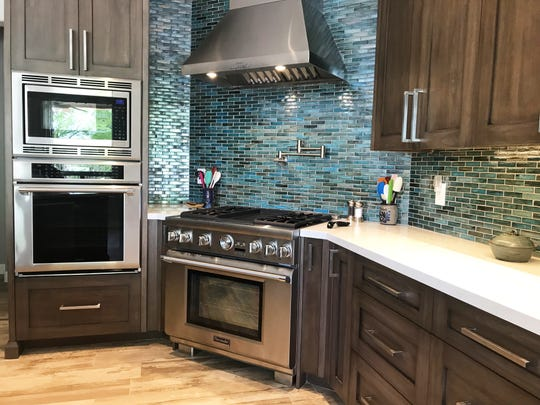 The homeowners bought this affordable house in Gold Canyon when they moved from Kansas. They plan to remodel their home in segments, and sicne their lifestyle includes a lot of entertaining, they started from the kitchen.