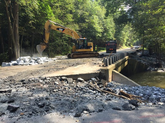 Crews working on the bridge over Hammer Creek on Route 322 in Elizabeth Township, Lancaster County Sept. 4, 2018. All of the blacktop on the bridge was washed off by floodwaters Aug. 31 causing Route 322 to be closed in Lebanon County at Boyd Street in Cornwall Borough. The roadway is expected to be opened by Sept. 14.