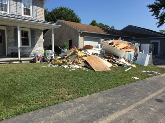 A pile of debris outside a Richland home which is under construction after 16 inches of floodwater found its way inside.