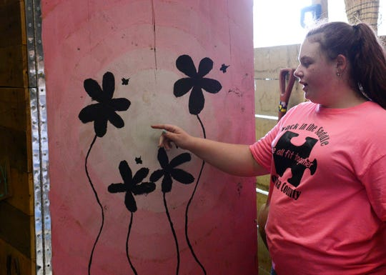 Emma Eck, 14, shows the side of the tack box she painted.