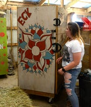 Lexi Eck, 18, shows the side of the tack box she decorated.