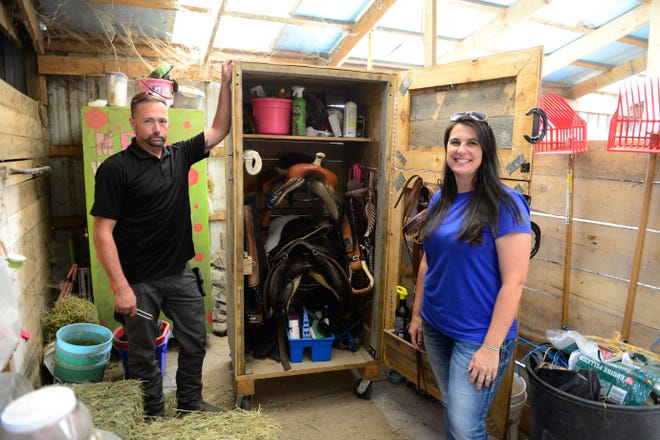 Jason, left, and Melissa Eck show the tack box they made.