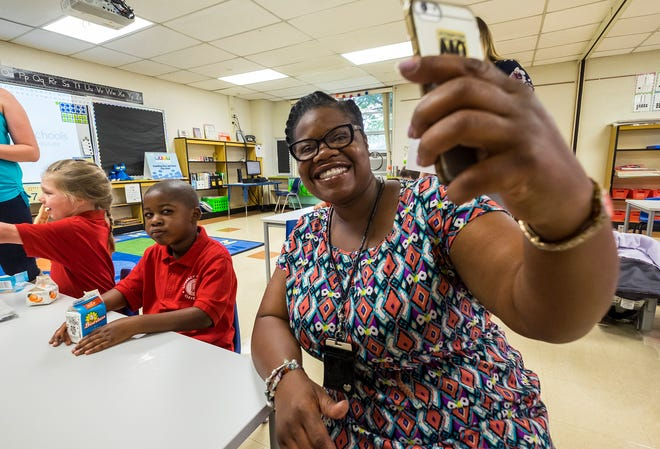 Andrea Edwards takes a selfie with her son Jamaine Walker Jr. Tuesday, Sept. 4, 2018, on his first day of kindergarten at the Literacy Academy at Cleveland.