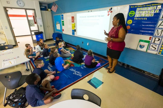 Third grade teacher Cerees Hazels goes through beginning of day procedures with her class Tuesday, Sept. 4, 2018, on the first day of school at the STEAM Academy at Woodrow Wilson.