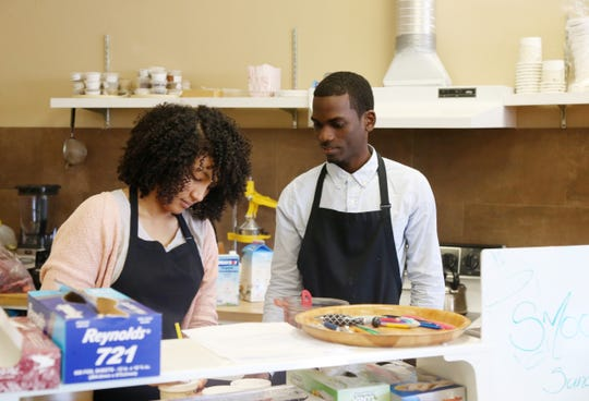 From left, Inga and Renoir St. Juste prepare an order for a customer at Eden Life Market in Pleasant Valley on August 23, 2018. The St. Justes recently purchased the long time health food market and have been making strides to bring in new products to lure new customers.