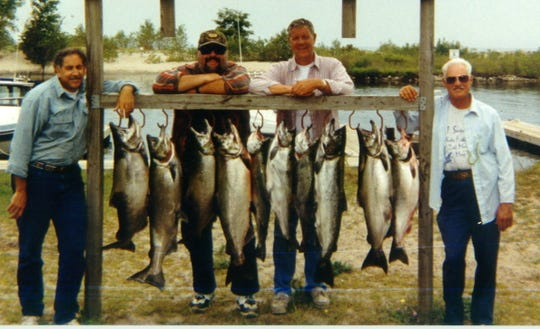Four anglers who Bill Conners says would probably admit that this was one of their most successful fishing outings on Lake Ontario. Three of the four have passed away. From left to right: Tom Fiumarello of Hyde Park, Ken Gonyea (d. 2003) Paul Wizeman (d. 2014) and Joe Molinaro (d. 2018).