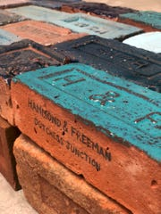 "Julia Whitney Barnes glazed one example from each brickyard a greenish-blue hue to represent the river in her installation ""Hudson River of Bricks,"" which will be unveiled Sept. 7 at the Poughkeepsie Trolley Barn."