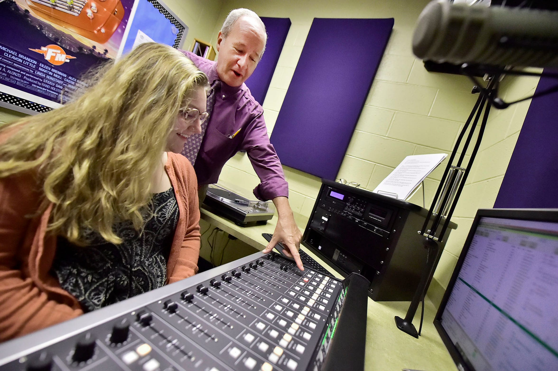 Andy Berrier teaches student Zoe Hobbs, 17, about the equipment in their radio station. Chambersburg Area School District started a radio station about 18 months ago. Students are being trained to go on air.