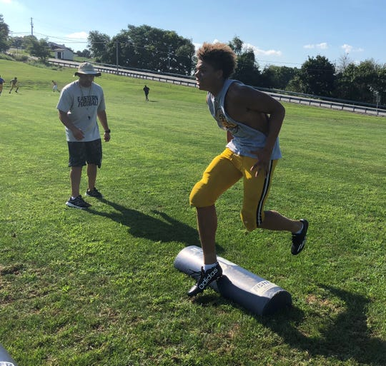 Eastern York wide receiver Demonte Martin runs through a drill run by head coach Josh Campbell last season. Martin was one of three York County players to excel in Sunday's Pennsylvania Football Coaches Association East-West Game.