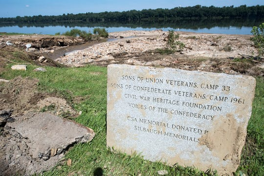 This Civil War monument was washed away from the road in Friday's flash flooding. The base washed a couple hundred feet farther. Resident Eileen Musser hopes to get the monument, which marks where a Civil War soldier was found dead, farther away from Dugan's Run. The stone is actually a replacement for one that washed away in 2011 flooding, she said. Barren land in the background is the debris carried out into the Susquehanna River by Friday's storm.