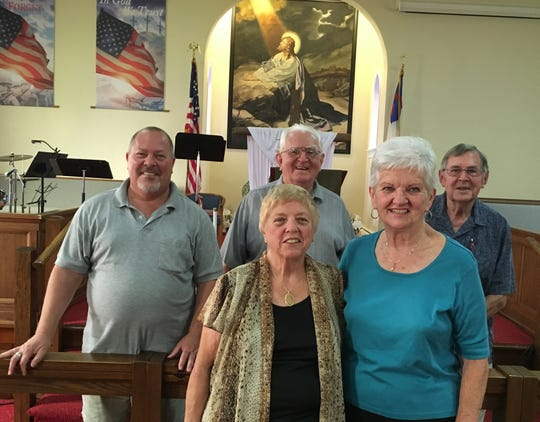 Pictured are:  (front row)  Pastor Dawn Spangler and 125th anniversary committee chair Earlyn Repman; (back row, from left) long-time church members Shawn Wentz, Ray Hykes, and Ellwood Repman.