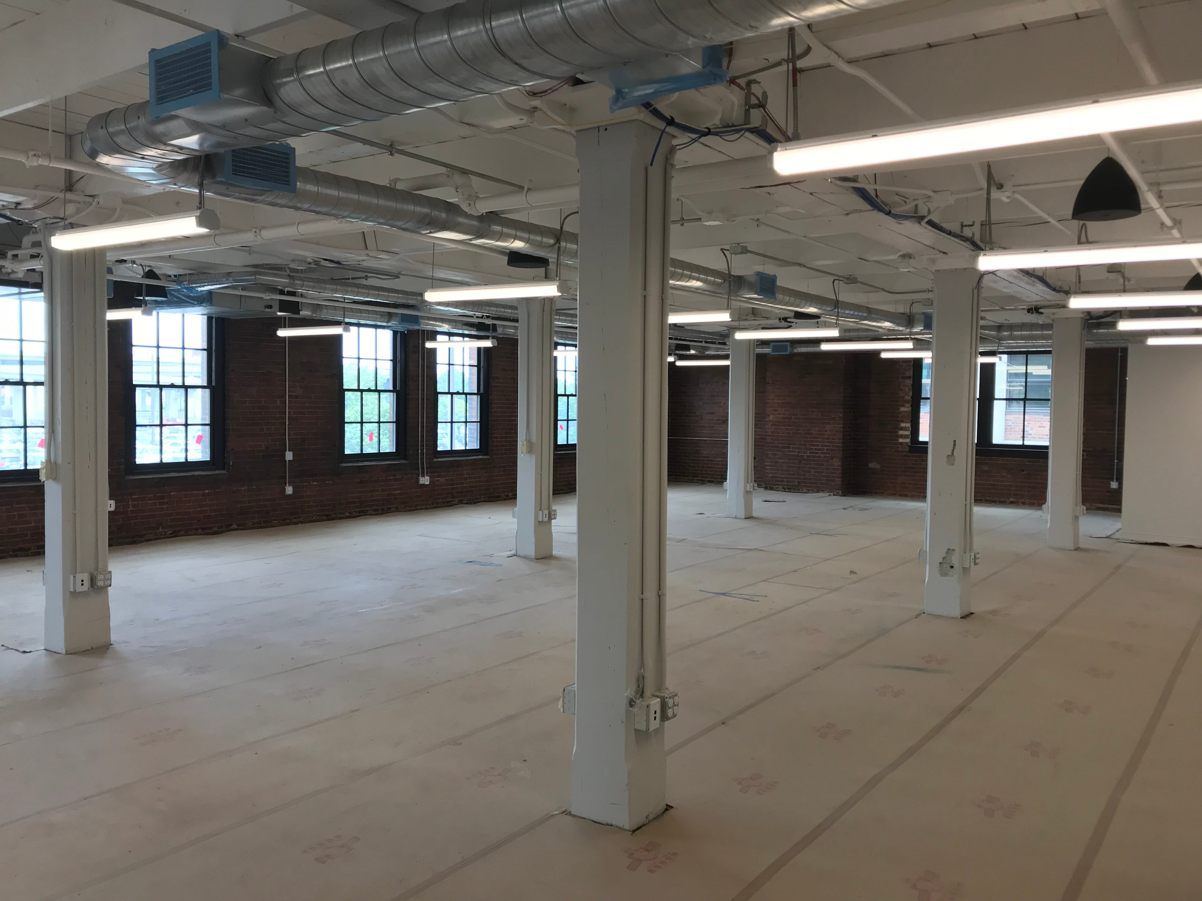 Second-floor office space for the sales and marketing staff of Labatt USA at the Labatt Brew House in Buffalo.