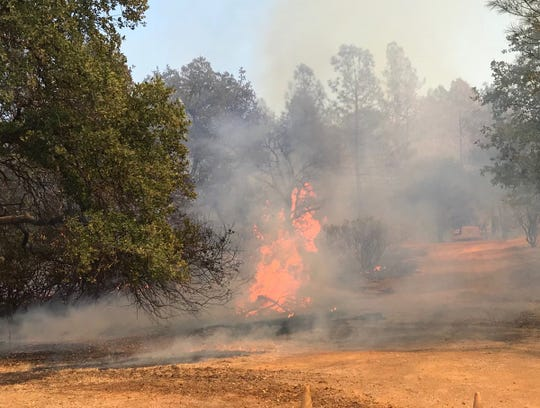 The Ranchera Fire on Tuesday, Sept. 4, 2018 burns toward Toyon Street in Shasta Lake.