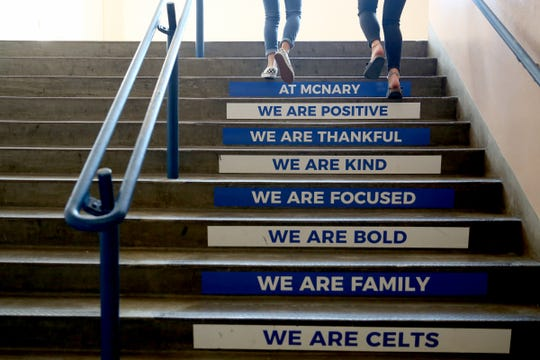 Students walk up a flight of stairs on the first day of school of ninth graders at McNary High School in Keizer, Sep. 4, 2018.