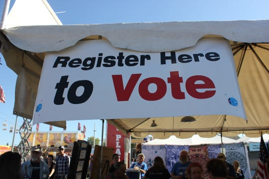 A sign hanging on the Democratic Party of Oregon's booth at the Oregon State Fair on Monday, Sept. 3, 2018.
