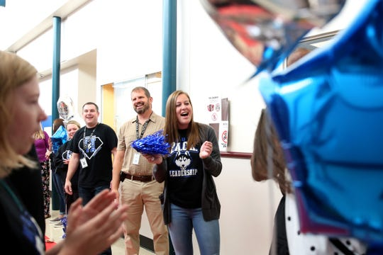 Teachers welcome sixth graders on their first day at Houck Middle School in Salem on Tuesday, Sep. 4, 2018.