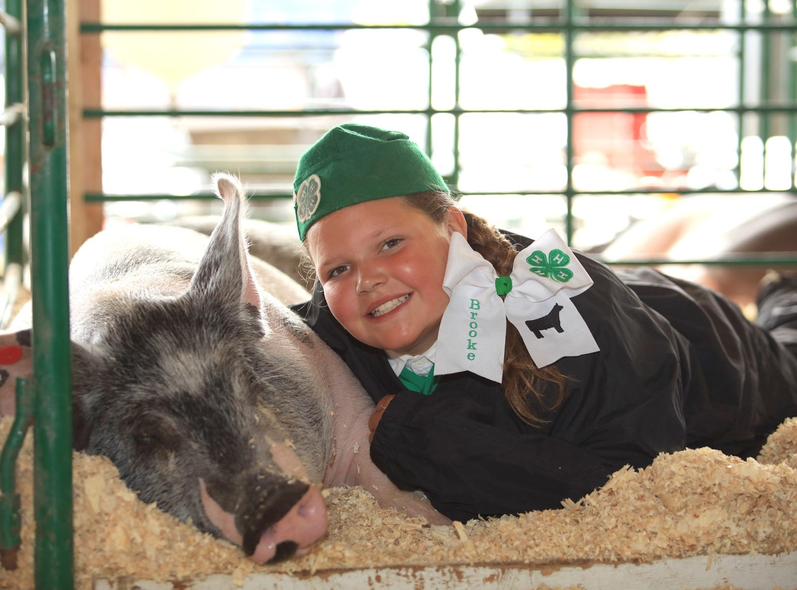 Brooke Mullins, 11, hangs with her Chualar 4H entry.