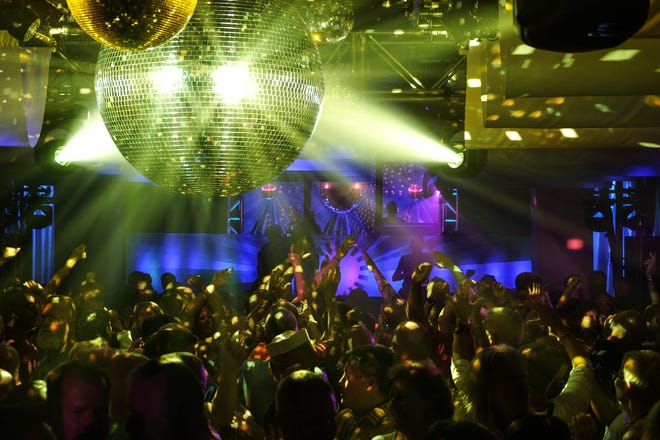 Hundreds danced under a disco ball at Sundance, CAMP Rehoboth's 31st annual fundraiser that was held Sept. 1 and 2 at the Rehoboth Beach Convention Center. Sundance was held this year in memory of CAMP Rehoboth co-founder Steve Elkins, who died of lymphoma earlier in March.