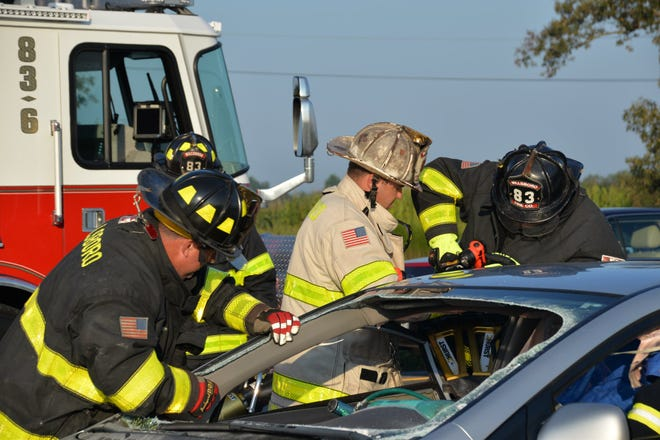 The Millsboro Fire Company works at the scene of a crash at the intersection of Dupont Highway and the Avenue of Honor on Tuesday, Sept. 4.