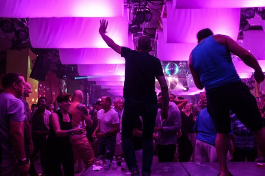 CAMP Rehoboth executive director Murray Archibald dances during Sundance, the nonprofit's 31st annual fundraiser, months after his husband and partner of almost 40 years, Steve Elkins, died of lymphoma. Sundance was one of Elkins' favorite events to plan and dance at.