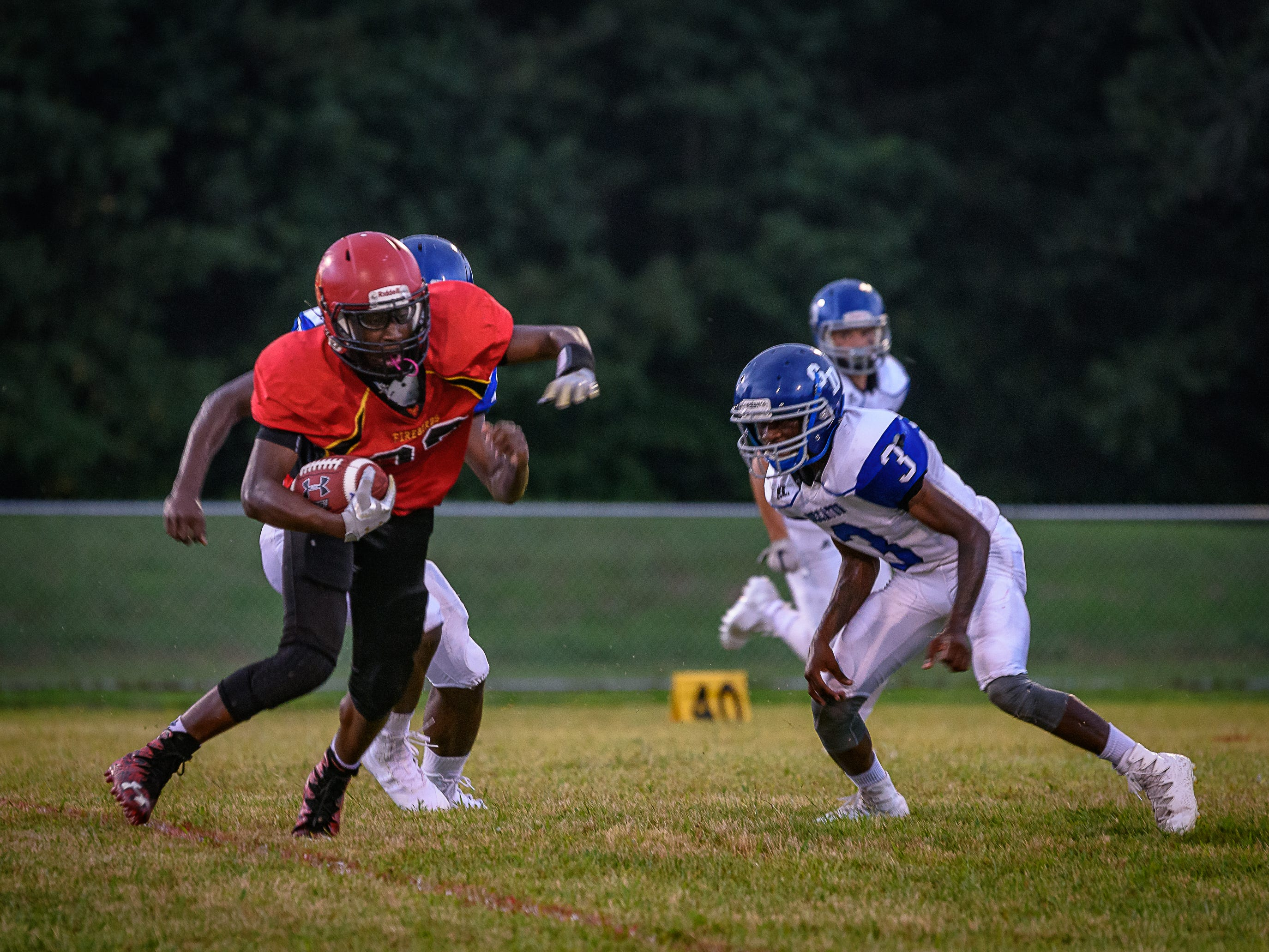 Arcadia's Jaden Hope tries to evade a tackle from Decatur's Shamar Briddell.