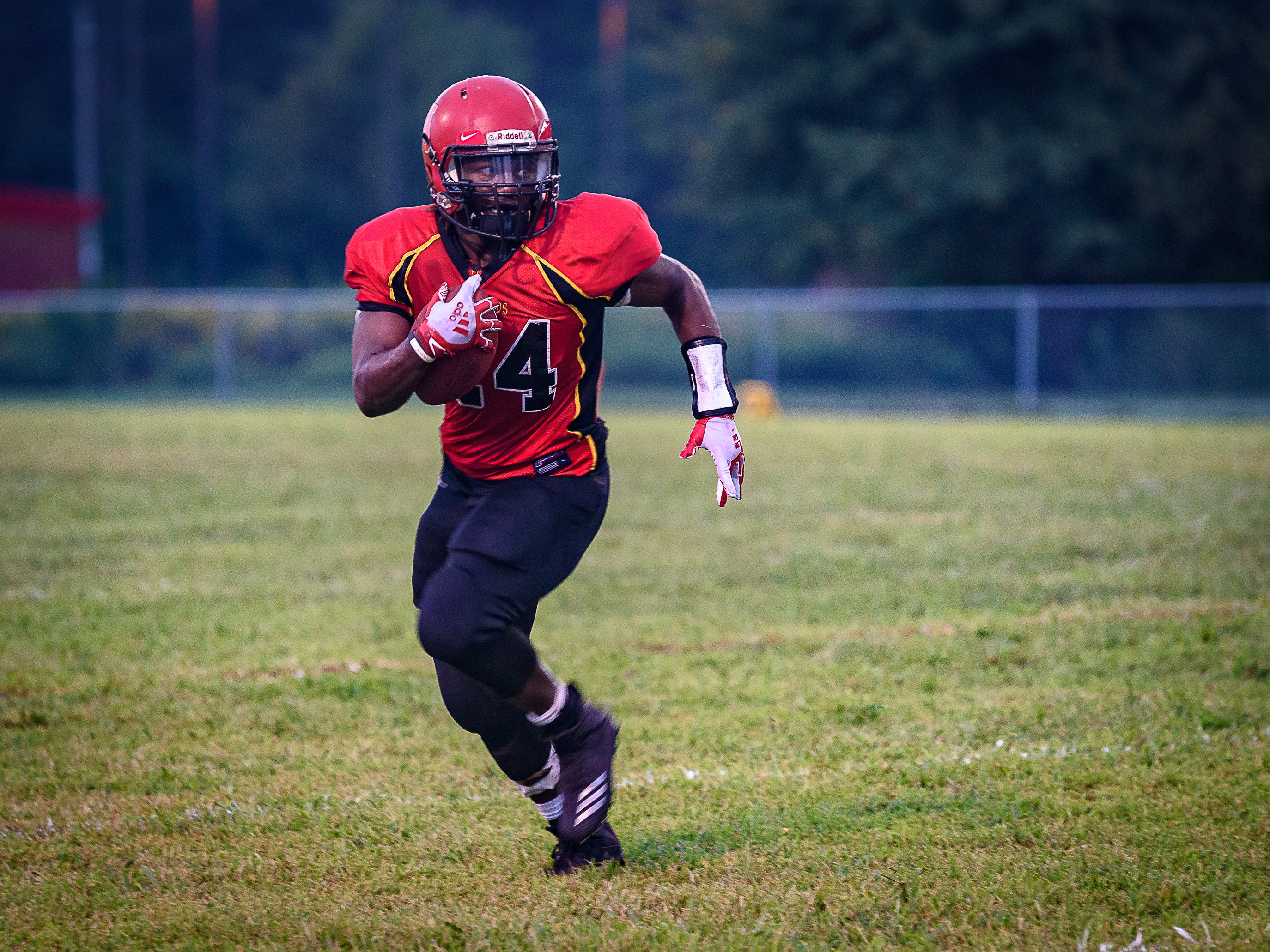 Arcadia's Bryden Bibbins catches a pass and heads across the field during the game against Stephen Decatur.