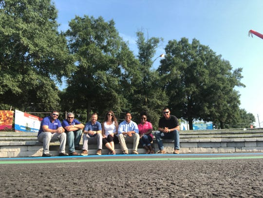 (From left to right) Team members, Chris Eccleston, Jake Meadows, Daniel Mills, Kathryn Ellis, David Diaz and Rich Hertzog gather at the newly completed Salisbury City Amphitheater in front of La Quinta on the south prong of the Wicomico River. Delmarva Veteran Builders built the amphitheater and worked with Vista Design on the design of the space.