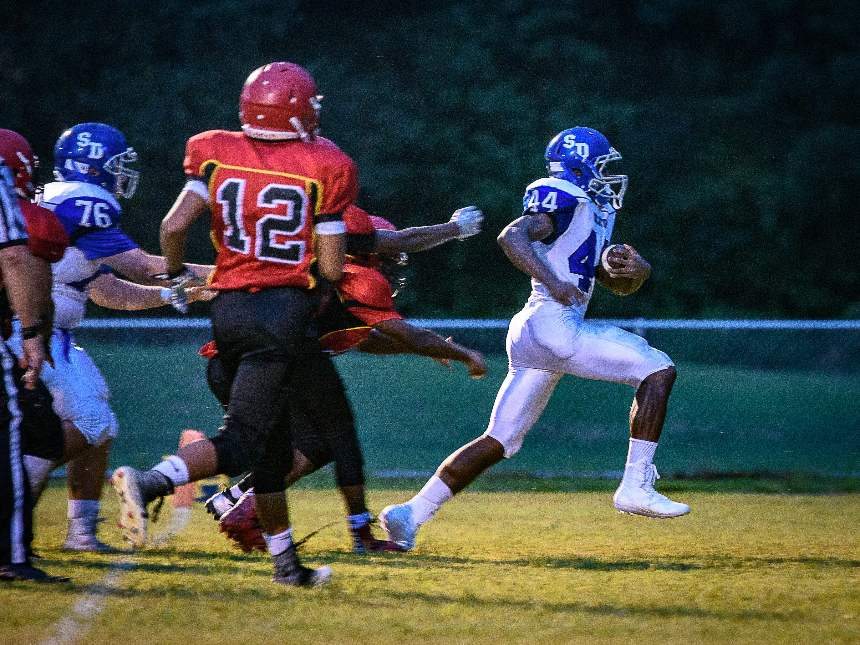 Decatur's London Drummond gets the ball into the end zone for a touchdown.