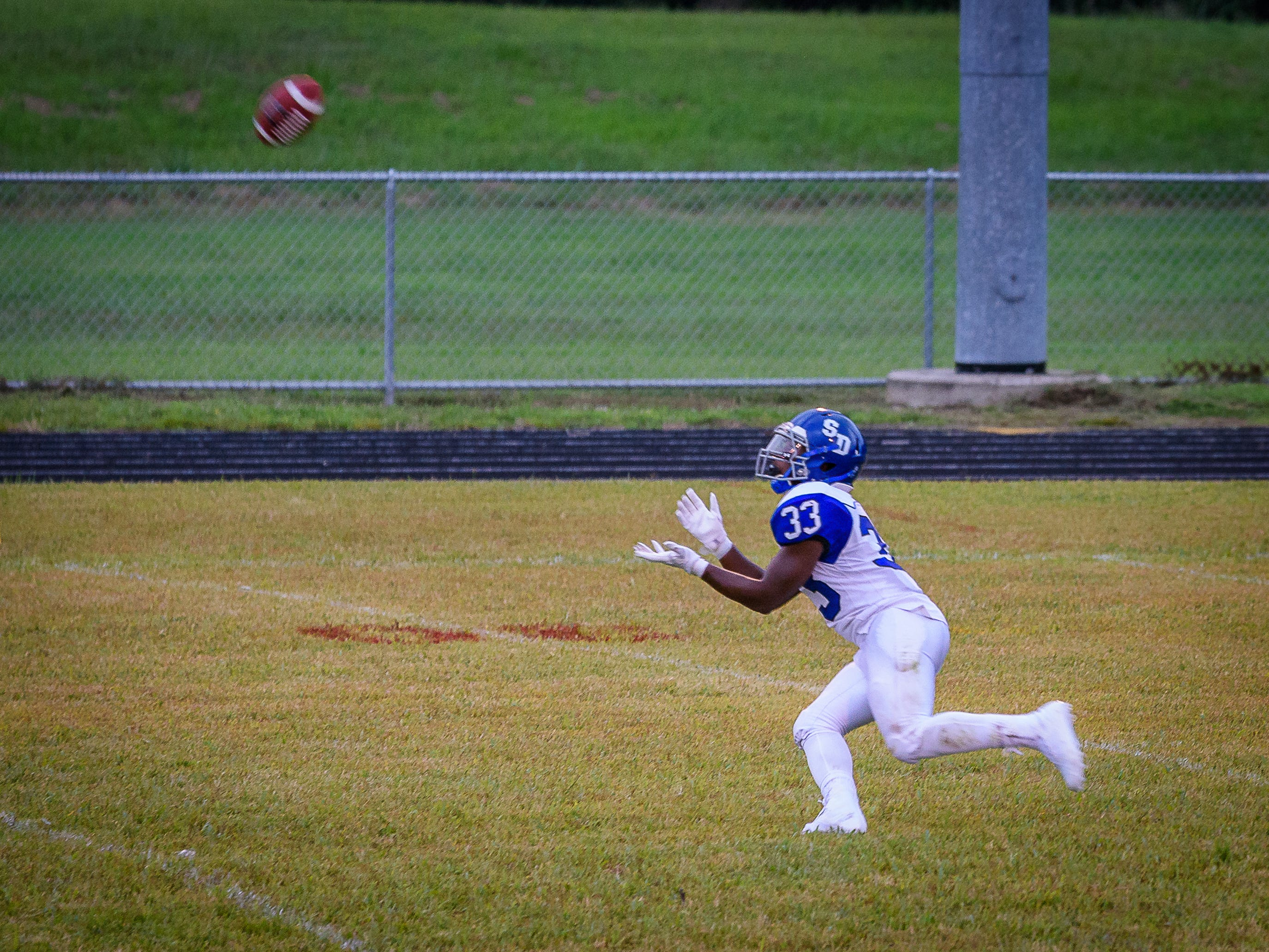 Stephen Decatur's Devin Waters gets under the ball after kickoff during the Berlin, Maryland, school's game at Arcadia High School on Friday, Aug. 31. Decatur won the game 58-20.