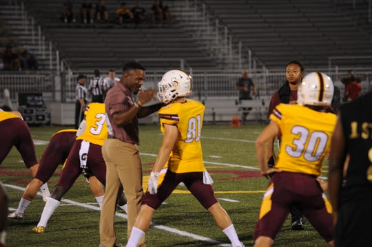 Isaiah Taylor chats with Salisbury University wide receiver Matt Scott prior to the Sea Gulls' Aug. 31 game against Albright College.