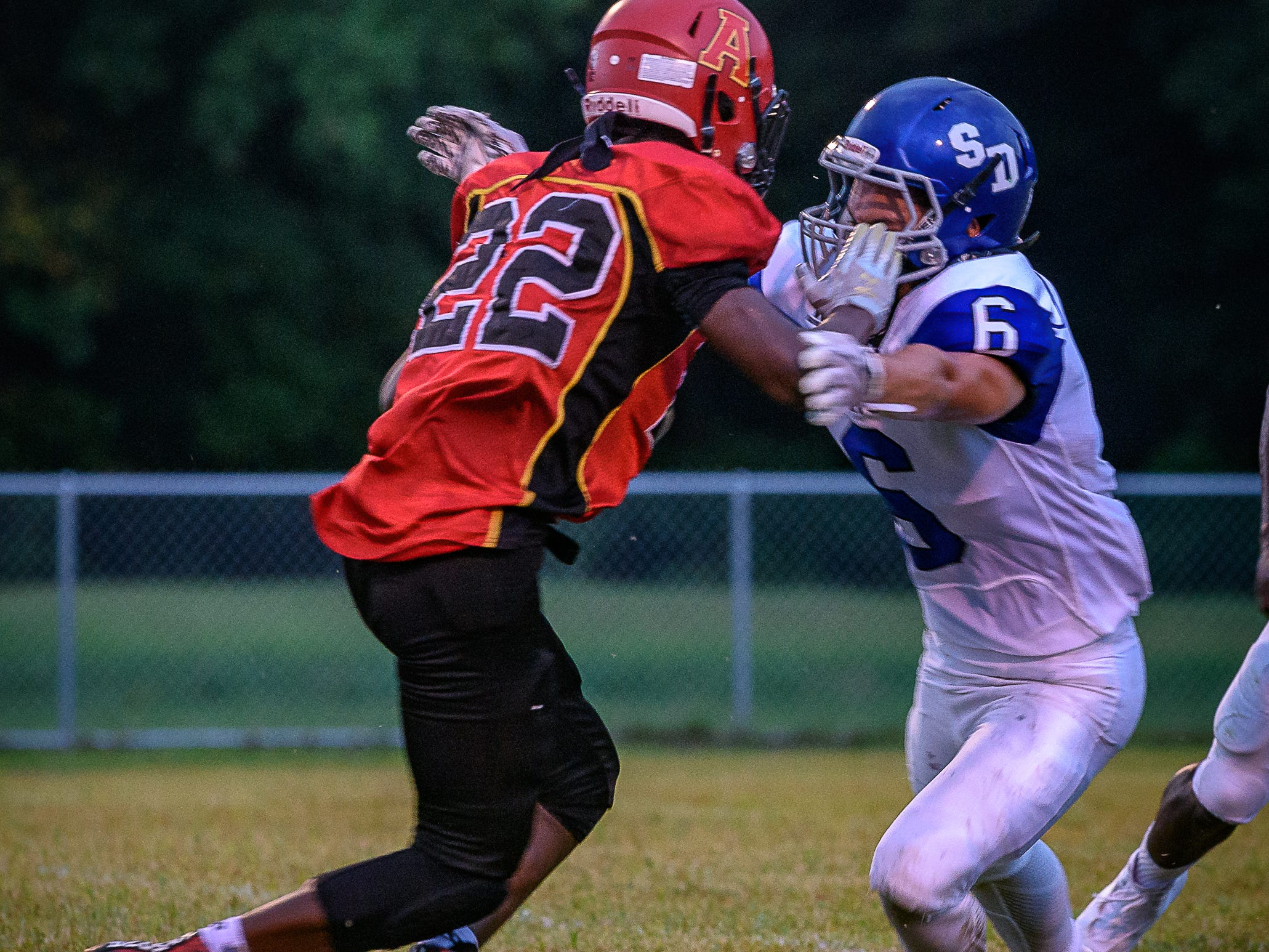 Arcadia's Jaden Hope, No. 22, tries to move the ball past Decatur's Cameron Bradshaw.