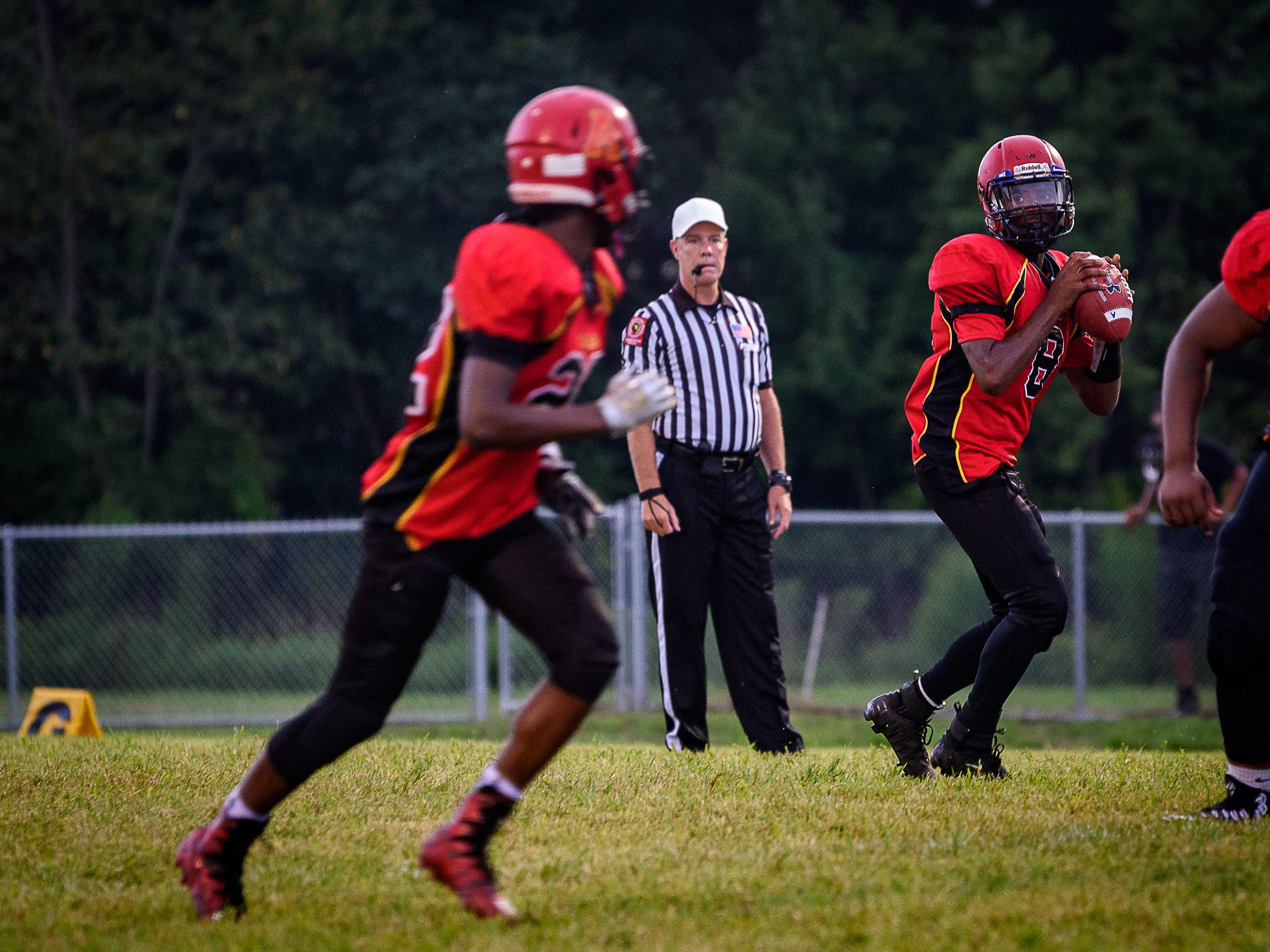 Arcadia's Lethon Williams, No. 8, prepares to pass to   Jaden Hope during the game against Stephen Decatur at home.