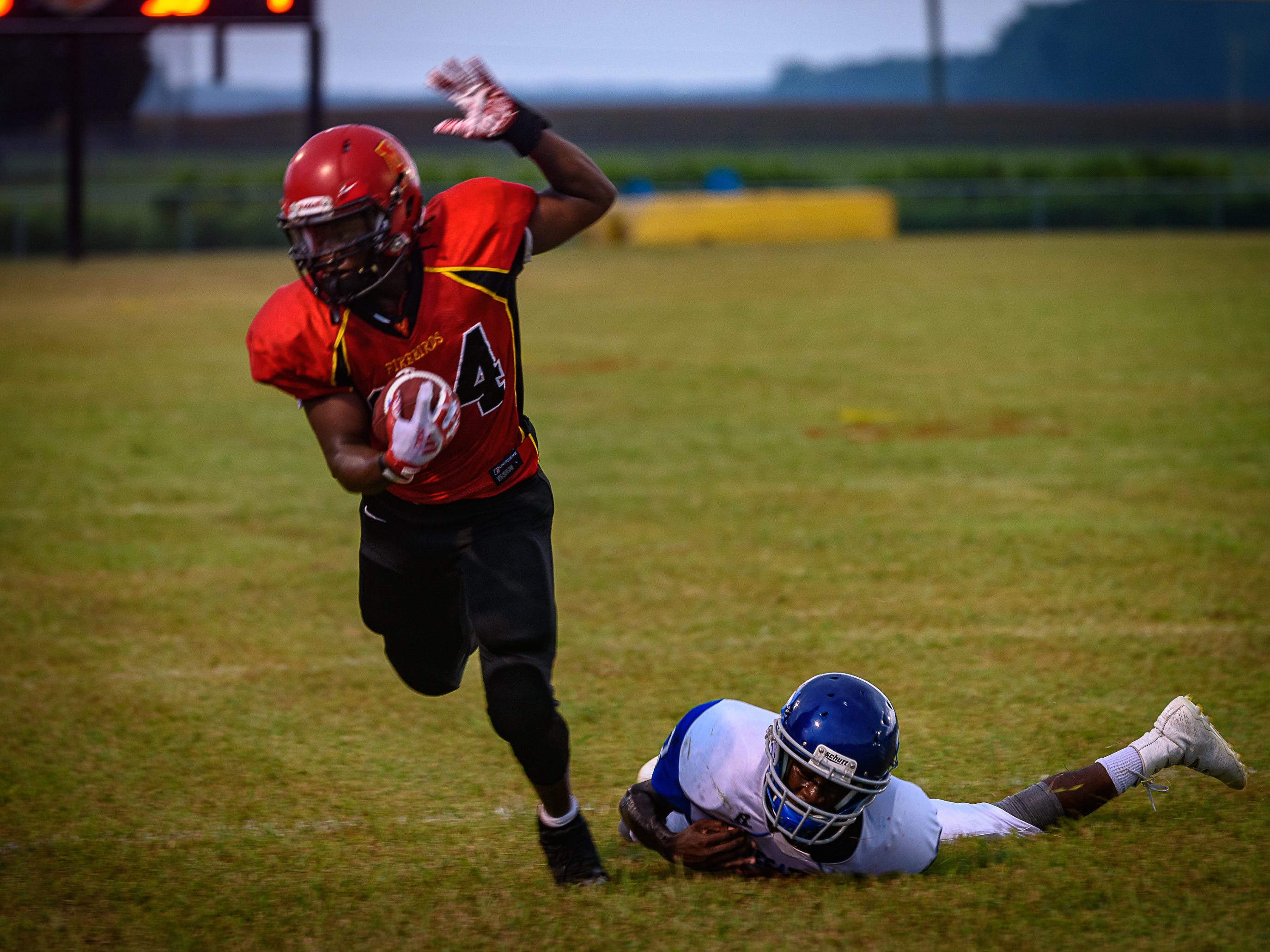 Arcadia's Bryden Bibbens breaks a tackle from Decatur's Shamar Briddell.