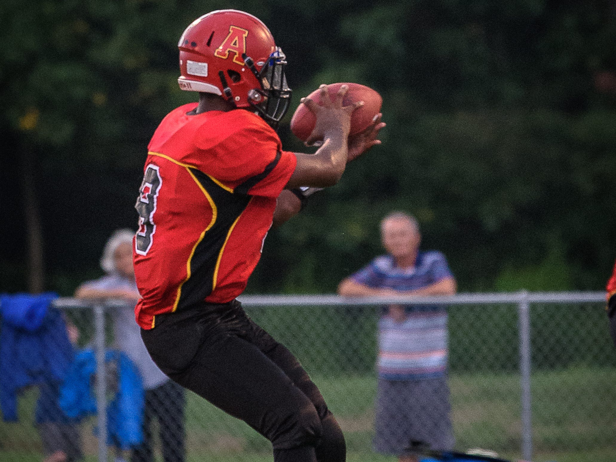 Arcadia's Lethon Williams takes a long snap during the loss against Decatur.