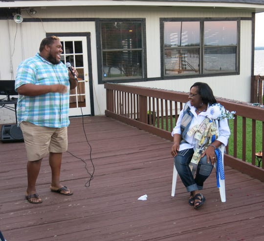 """Mark Scroggins sings """"Happy Birthday"""" on the deck at Valencia  to Dottie Bell at her 71st birthday fete."""