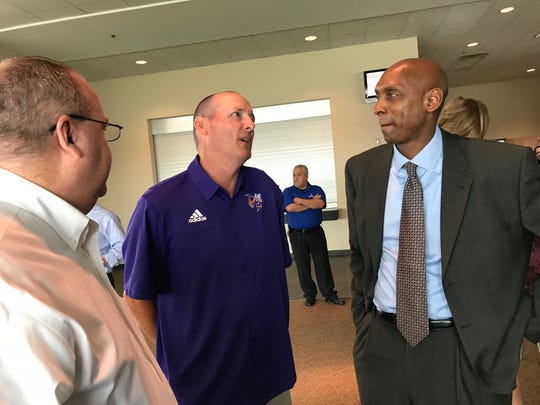 Byrd's Mike Suggs visits with Patrick Wesley during the 2018 Battle on the Border news conference.