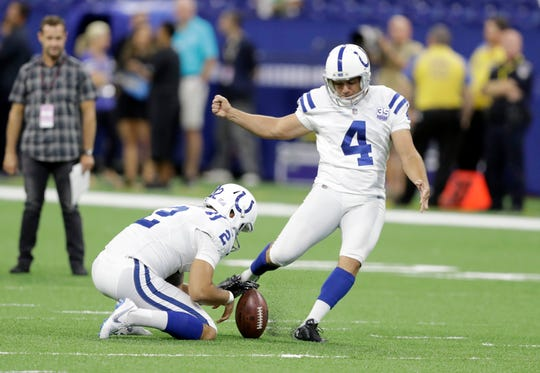 File- This Aug. 20, 2018, file photo shows Indianapolis Colts kicker Adam Vinatieri (4) warming up before an NFL preseason football game against the Baltimore Ravens in Indianapolis.  Vinatieri's resume makes a solid case that he's the best kicker in league history. But as the 45-year-old enters his 23rd season, Vinatieri has his eyes on bigger feats. He needs seven field goals to pass Morten Andersen (565) for the most in league history. (AP Photo/Darron Cummings, File)