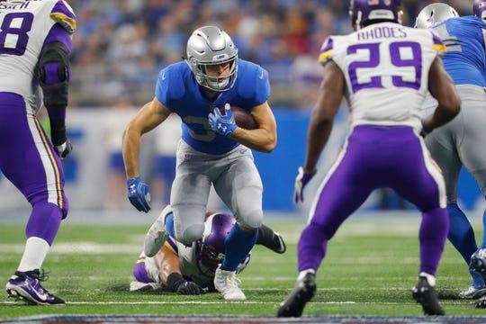 Detroit Lions running back Zach Zenner (34) runs against the Minnesota Vikings during an NFL football game in Detroit, Thursday, Nov. 23, 2017. (AP Photo/Paul Sancya)