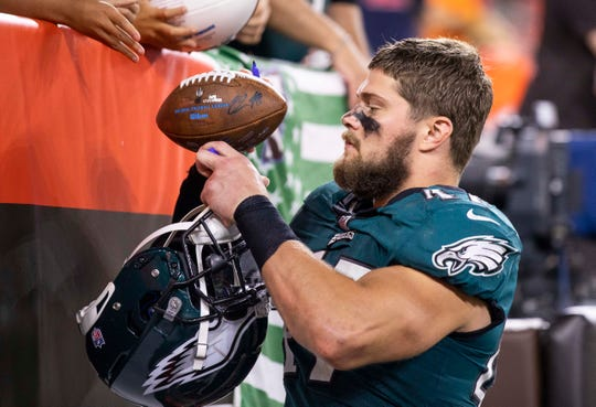 Aug 23, 2018; Cleveland, OH, USA; Philadelphia Eagles linebacker Nate Gerry (47) signs an autograph following the game against the Cleveland Browns at FirstEnergy Stadium. The Browns won 5-0. Mandatory Credit: Scott R. Galvin-USA TODAY Sports