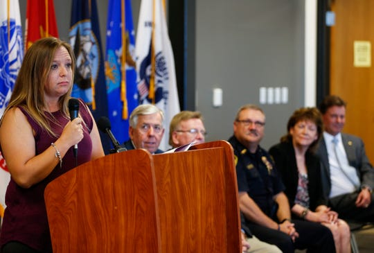Angie Presley tells her story about how Greene County's drug treatment court helped her in front of Missouri and Springfield law makers on Tuesday, Sept. 4, 2018. Presley has been sober for 14 years now and credits her triumph over prescription drugs to Greene County's drug treatment court.