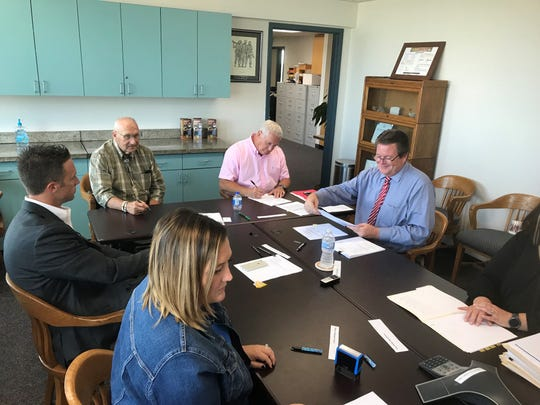 Greene County Commissioners sign documents in September 2018 finalizing a bond sale with proceeds of $69.7 million.