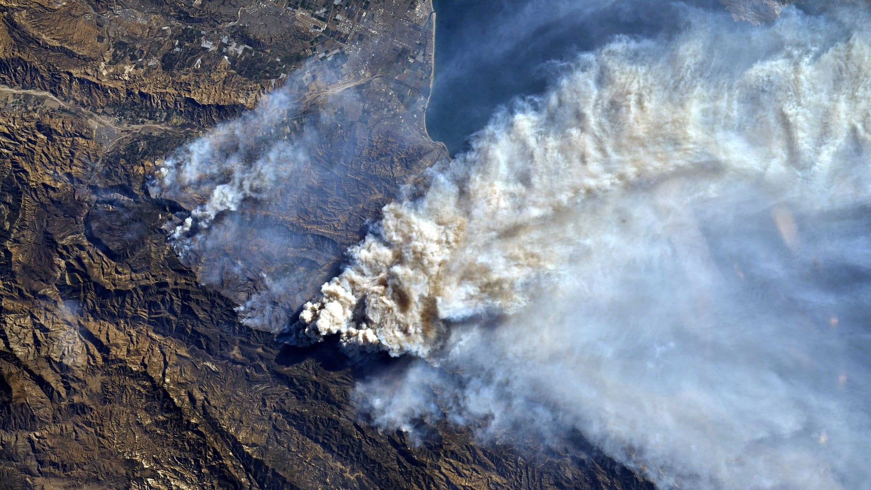A look at the environmental effects of wildfire, including smoke and ruin, climate change and regeneration.