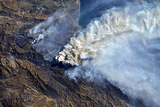 This Dec. 7, 2017, photo by NASA astronaut Randy Bresnik from the International Space Station shows smoke from California wildfires. Whether sparked by lightning or humans, fire has long been a force shaping the landscape of the U.S. West.