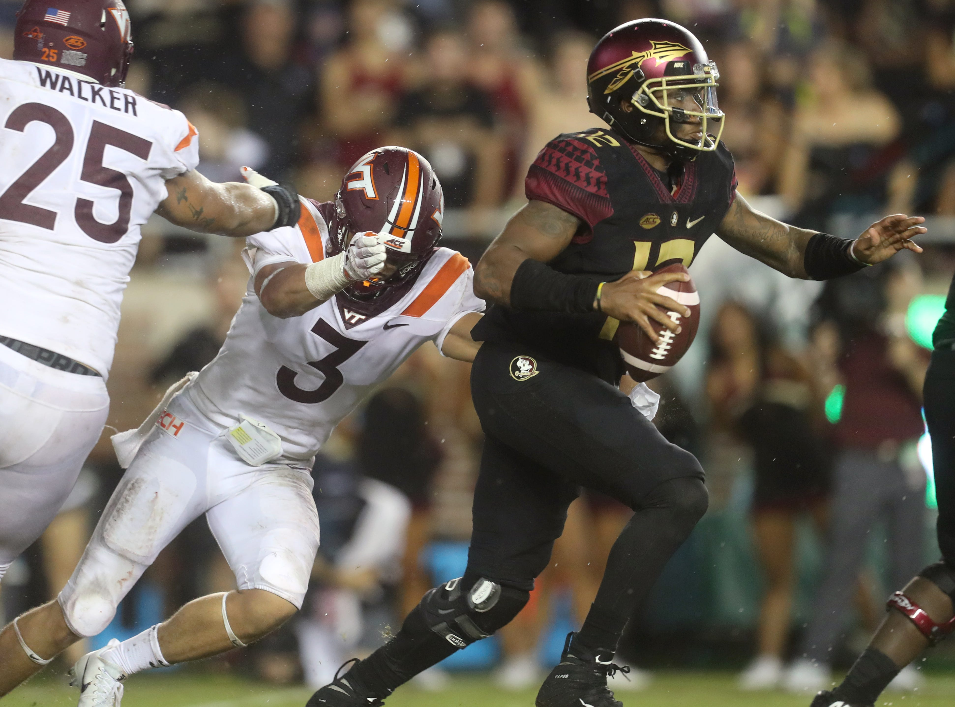 FSU's Deondre Francois is dragged down for a sack by Virginia Tech's Caleb Farley during the Hokies' 24-3 at Doak Campbell Stadium in Tallahassee, Fla. On Monday, Sept 3, 2018.