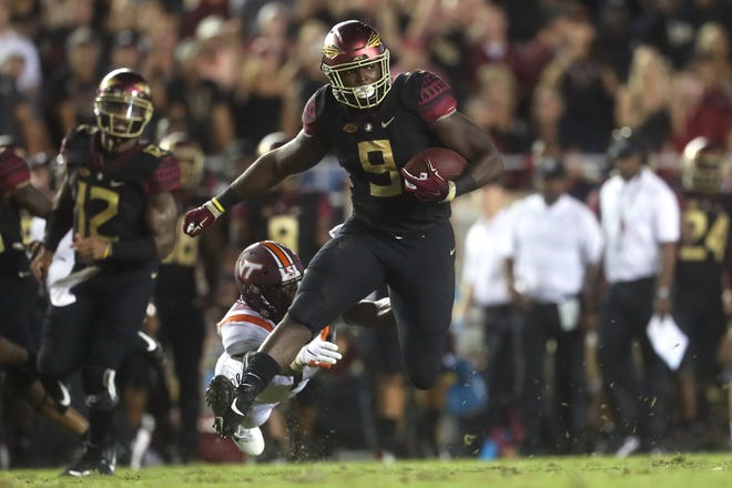 FSU's Jacques Patrick bereaks away from Virginia Tech's Divine Deablo during their game at Doak Campbell Stadium in Tallahassee, Fla. on Monday, Sept. 3, 2018.