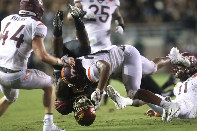 Virginia Tech's Rayshard Ashby tackles FSU's Jacques Patrick during their game at Doak Campbell Stadium in Tallahassee, Fla. on Monday, Sept. 3, 2018.