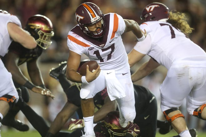 Virginia Tech quarterback Josh Jackson scrambles out of the pocket against FSU during their game at Doak Campbell Stadium in Tallahassee, Fla. on Monday, Sept. 3, 2018.