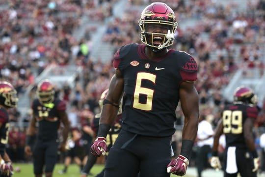 FSU's Tre' McKitty yells out to the crowd as he warms up before their game against Virginia Tech to open the season at Doak Campbell Stadium in Tallahassee, Fla. On Monday Sept. 3, 2018.