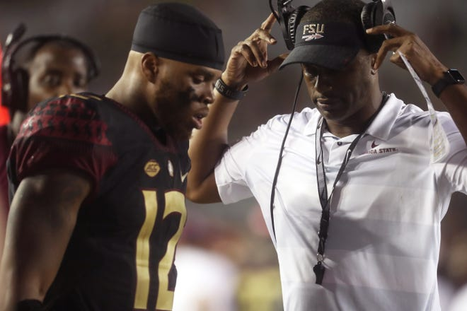 FSU Head Coach Willie Taggart and quarterback Deondre Francois chat on the sidelines during their 24-3 loss against Virginia Tech at Doak Campbell Stadium in Tallahassee, Fla. on Monday, Sept. 3, 2018.